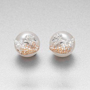 SWAROVSKI ICONIC SWAN pearl swan earrings